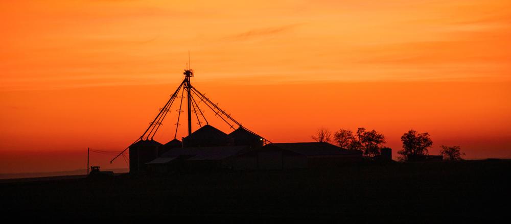 Sunset over a farm